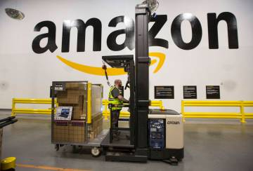 A forklift driver navigates through Amazon's North Las Vegas fulfillment center on Thursday, De ...