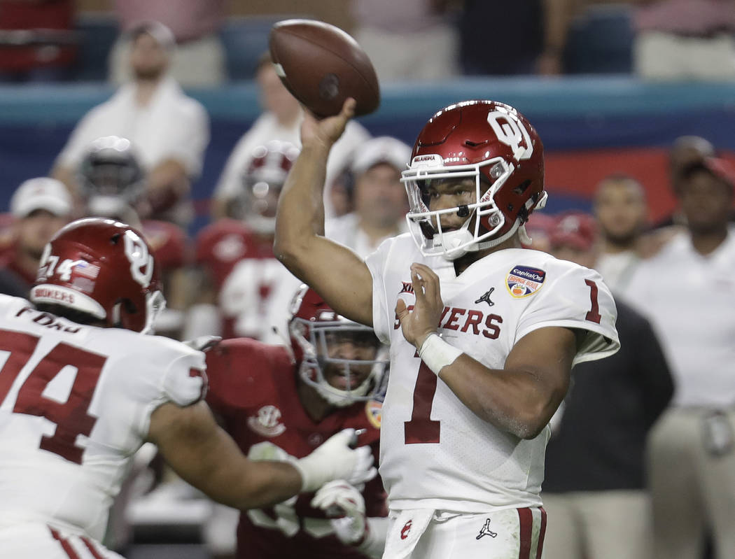 Oklahoma quarterback Kyler Murray (1) looks to pass, during the first half of the Orange Bowl N ...