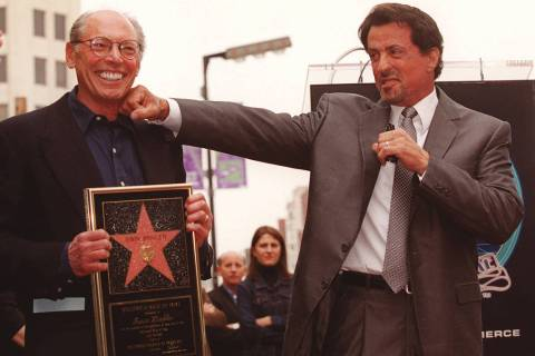 Actor Sylvester Stallone, right, lands a mock punch on the chin of producer Irwin Winkler durin ...