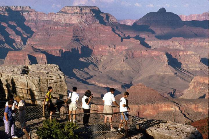 Visitors view the Grand Canyon from Mather Point on the South Rim at Grand Canyon National Park ...