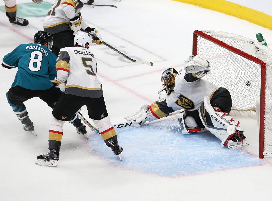 Knights goaltender Marc-Andre Fleury (29) makes a save against Sharks center Joe Pavelski (8) w ...