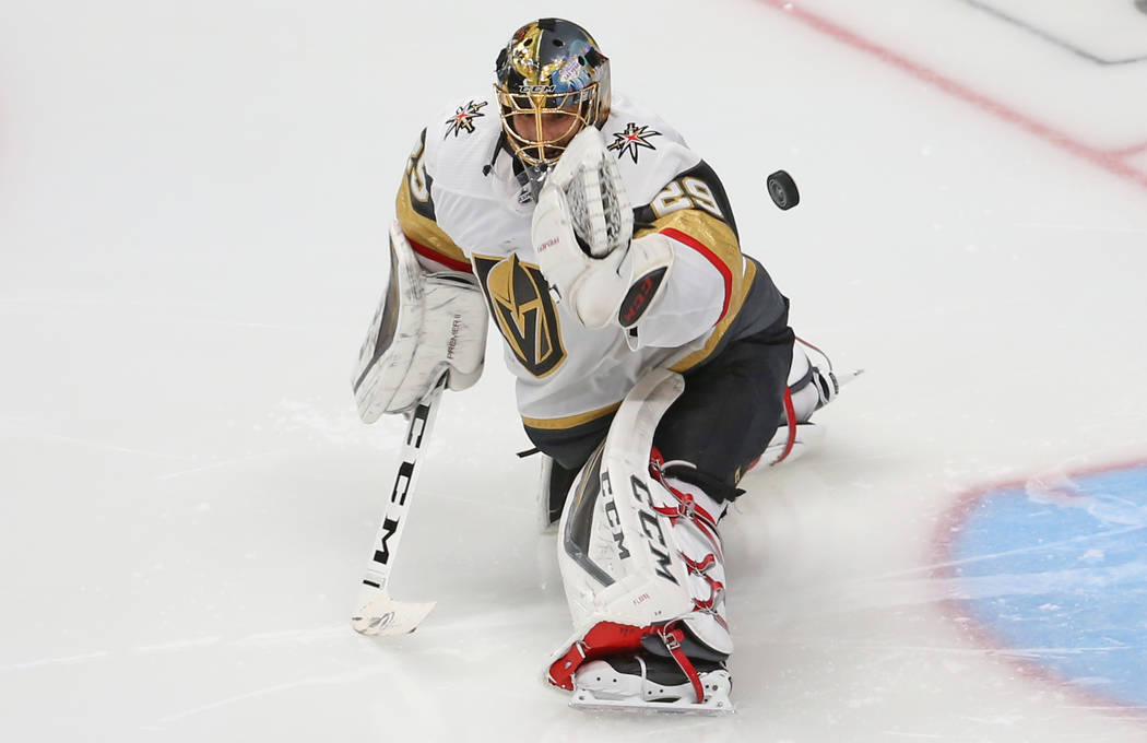 Golden Knights goaltender Marc-Andre Fleury (29) makes a save in the second period during Game ...