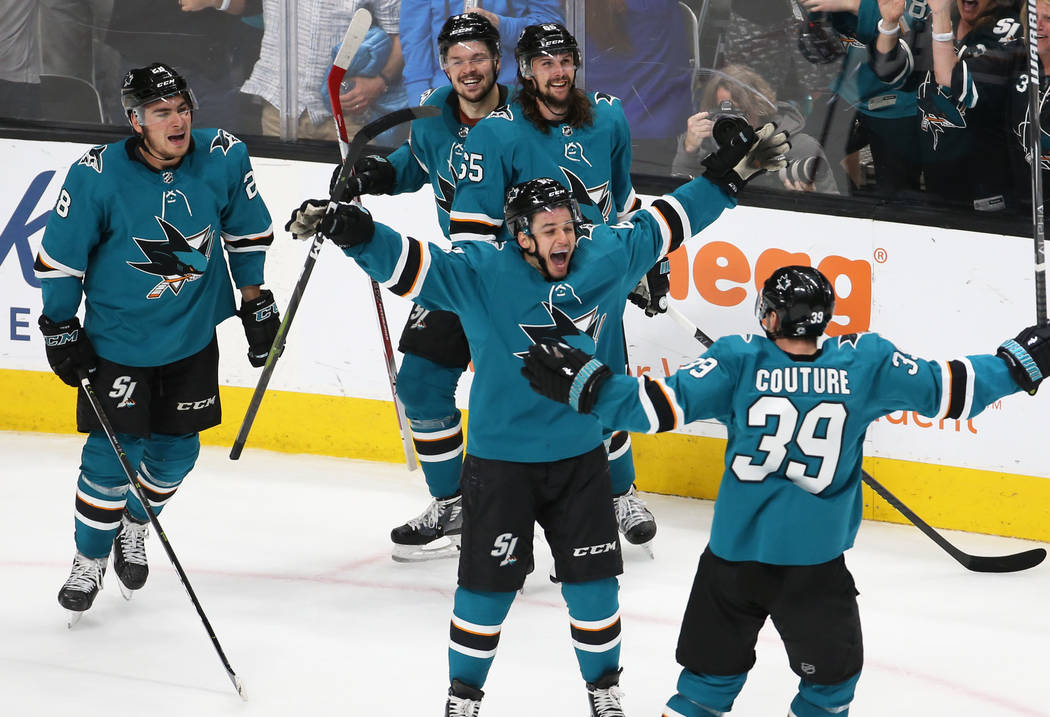 Sharks right wing Kevin Labanc (62) celebrates with Sharks center Logan Couture (39) after the ...