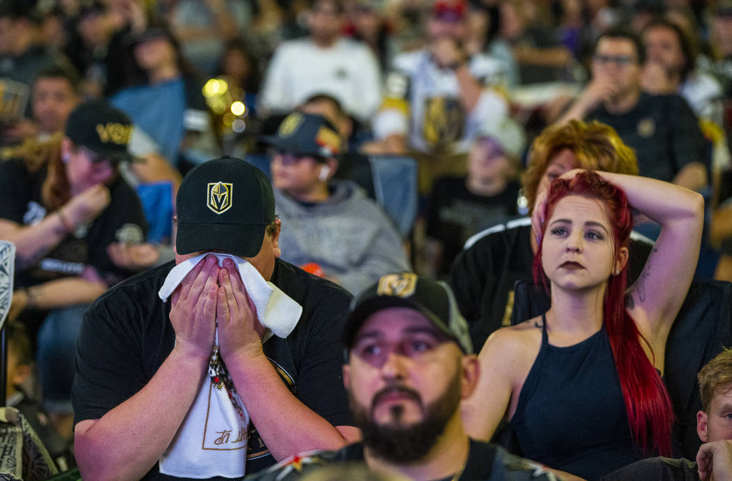 Golden Knights fans Michael and Rebecca Moore sit dismayed as the San Jose Sharks go up 4-3 dur ...