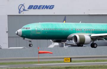 A Boeing 737 MAX 8 airplane being built for India-based Jet Airways lands following a test flig ...