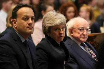 Ireland's Prime Minister Leo Varadkar, left, Britain's Prime Minister Theresa May and Irish Pre ...