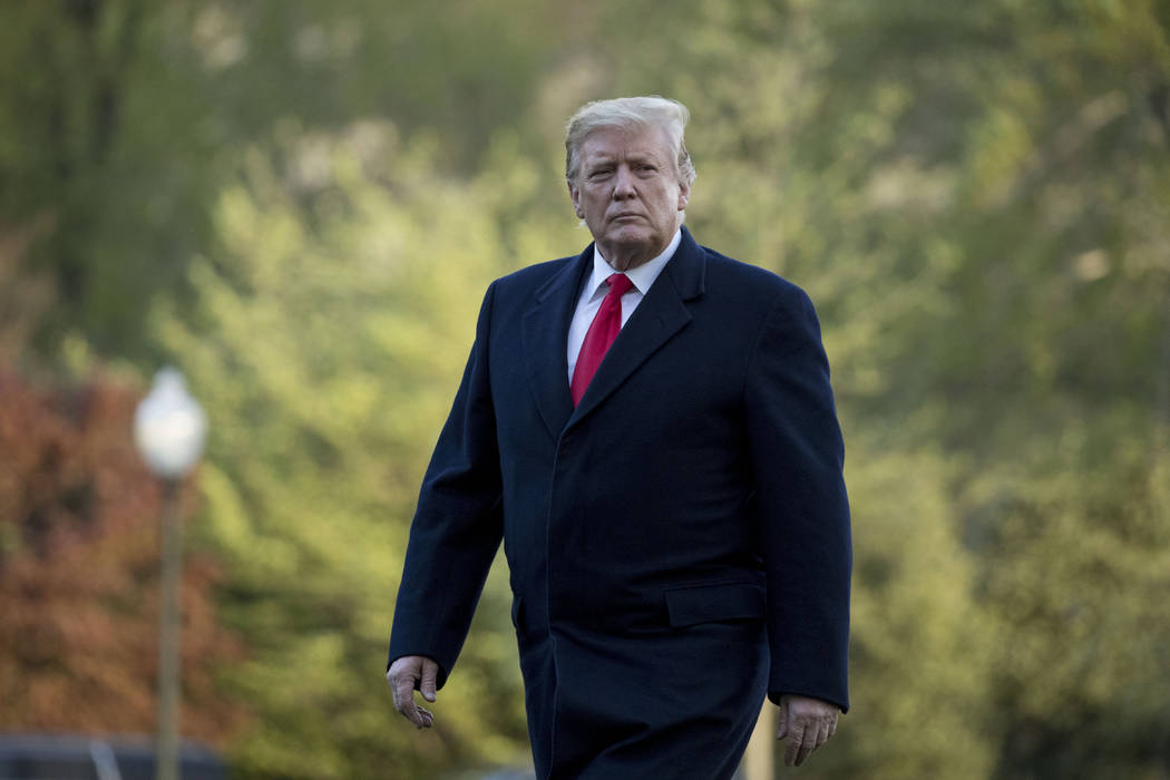 President Donald Trump walks on the South Lawn as he arrives April 15, 2019, at the White House ...