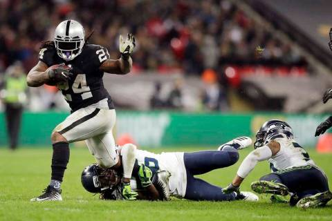 Oakland Raiders running back Marshawn Lynch (24) is tackled by Seattle Seahawks cornerback Shaq ...
