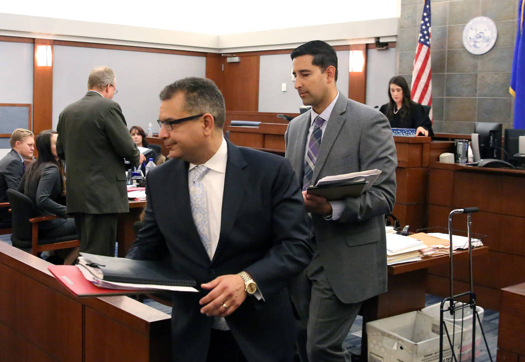 Defense attorney Christopher Oram, left, who represents former LVCVA executive Brig Lawson, and ...