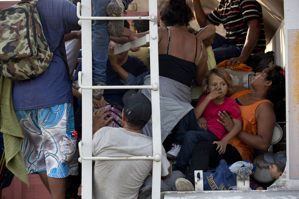 Central American migrants cram into a freight train during their journey toward the U.S.-Mexico ...