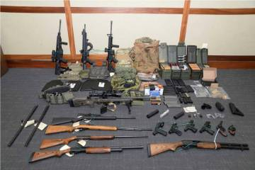 A file image provided by the U.S. District Court in Maryland shows a photo of firearms and ammu ...