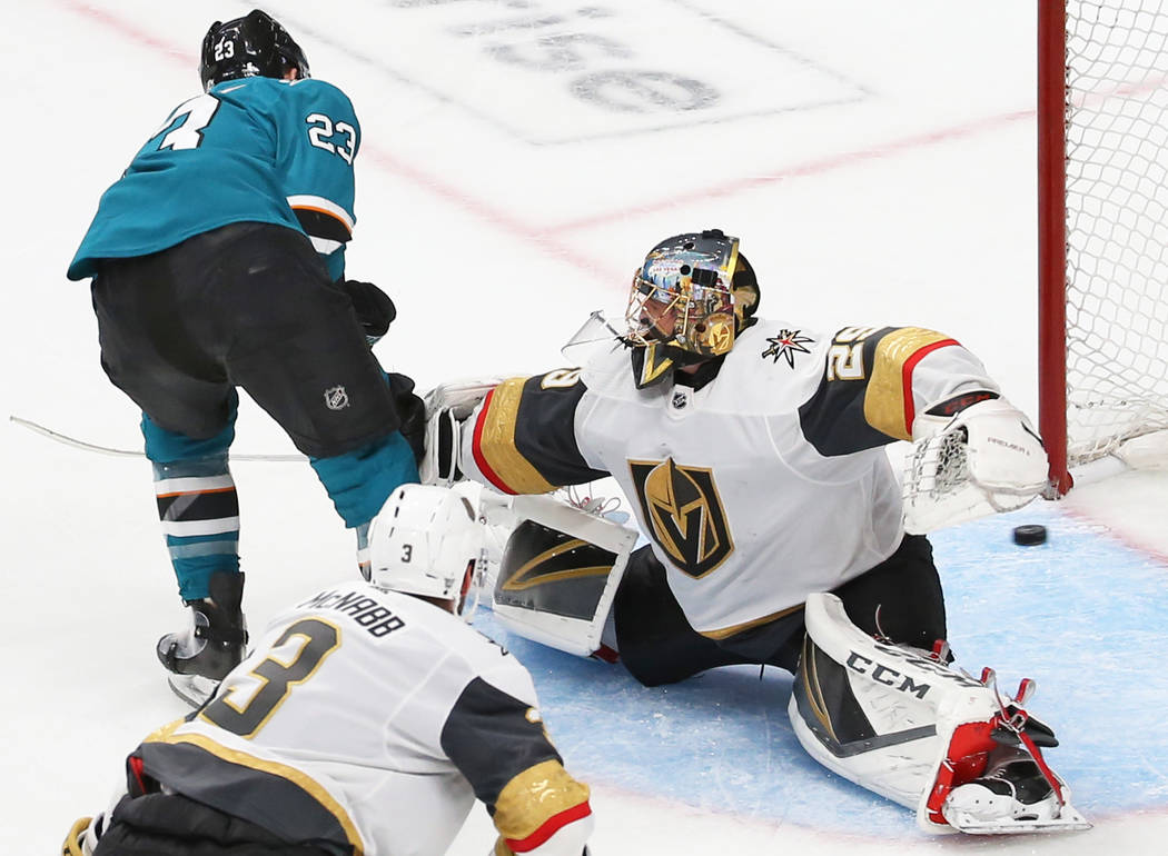 Sharks right wing Barclay Goodrow (23) scores against Knights goaltender Marc-Andre Fleury (29) ...