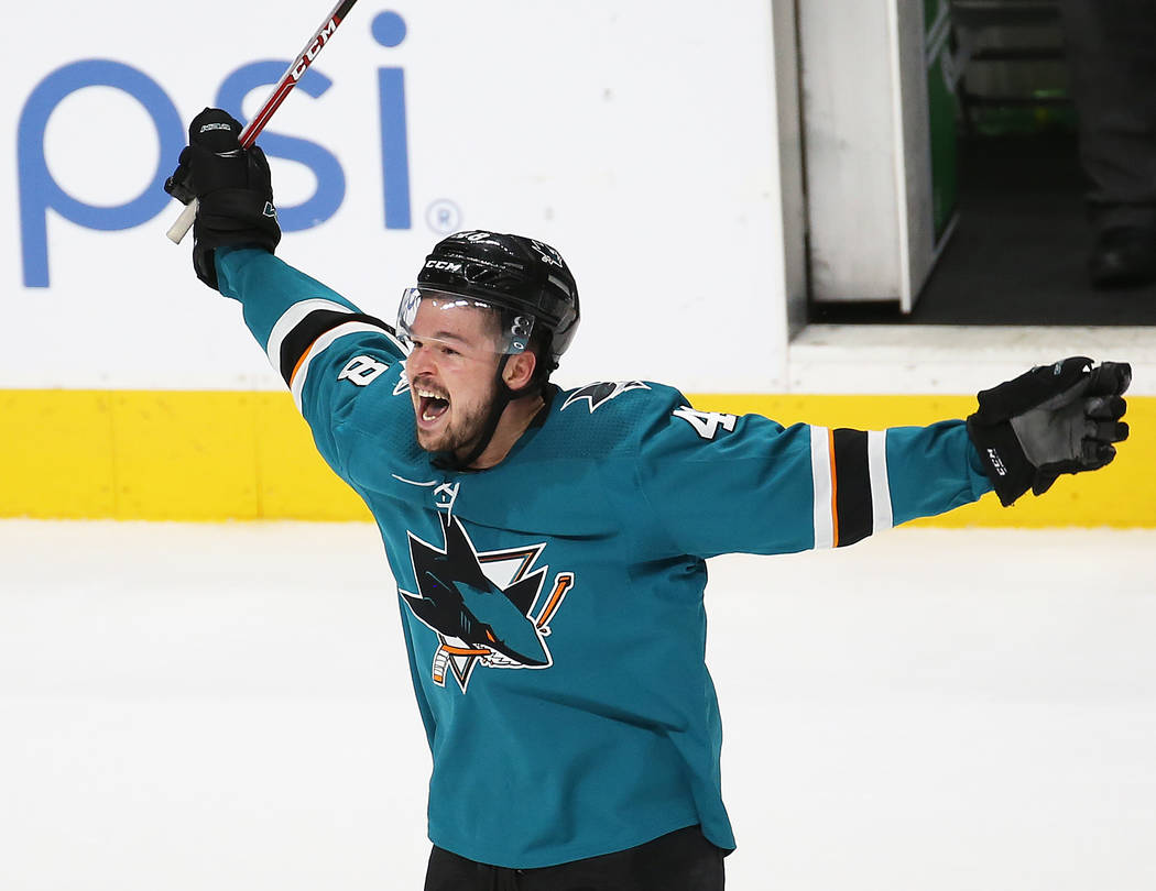 Sharks center Tomas Hertl (48) celebrates after Sharks right wing Barclay Goodrow scored the ga ...