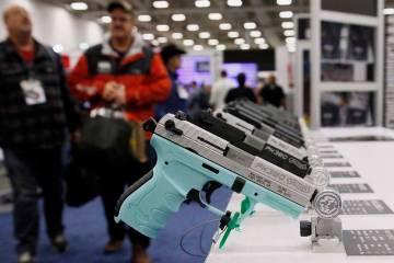 FILE - In this May 4, 2018, file photo, handguns are on display at the NRA convention in Dallas ...