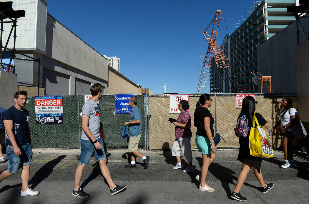 Pedestrians walk by a vacant lot that sits next to the Cable center shops on the Las Vegas Stri ...