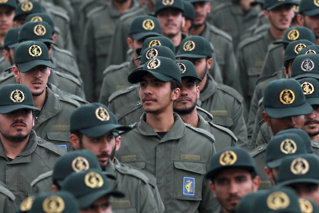 FILE - In this Feb. 11, 2019 file photo, Iranian Revolutionary Guard members attend a ceremony ...