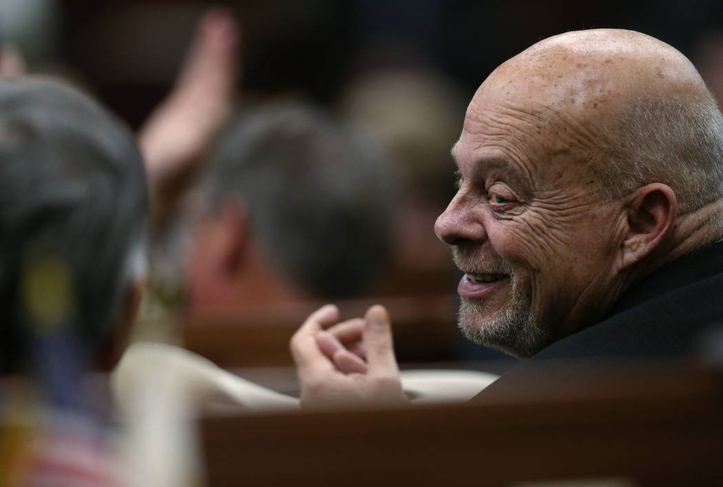 Nevada Assemblyman Jim Wheeler, R-Gardnerville, applauds as Nevada Gov. Steve Sisolak gives a s ...