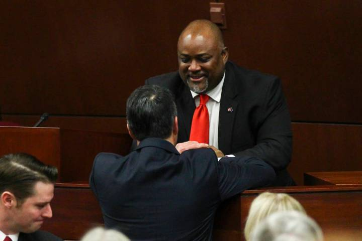 Assembly Speaker Jason Frierson greets Nevada Gov. Brian Sandoval following the State of the St ...