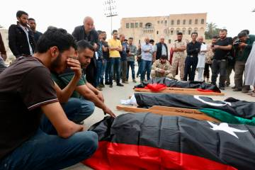 Mourners gather for funeral prayers for fighters killed by warplanes of Field Marshal Khalifa H ...