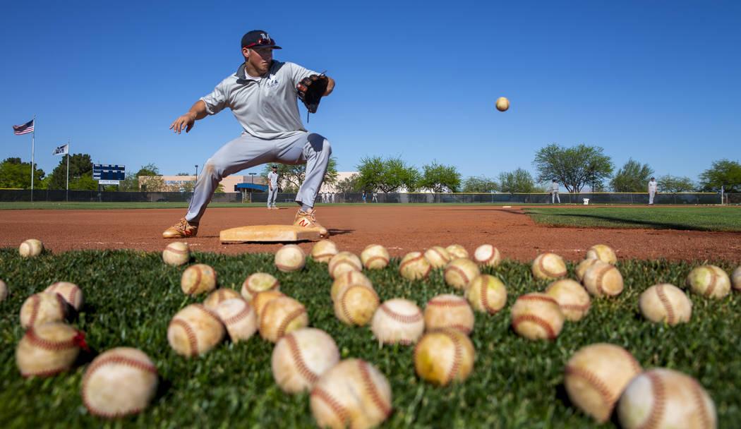 The Meadows School third baseman Sam Kaplan looks in a high ground ball during fielding practi ...