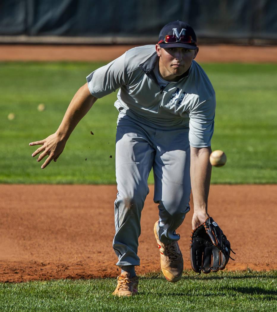 The Meadows School third baseman Sam Kaplan eyes a high bouncer during fielding practice, he wi ...