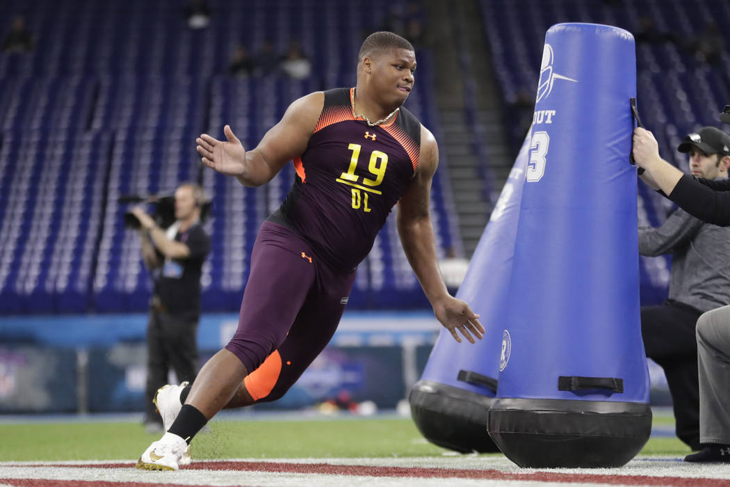 Alabama defensive lineman Quinnen Williams runs a drill at the NFL football scouting combine in ...
