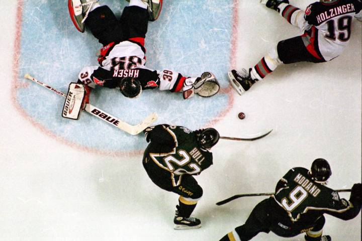 With one skate in the crease, Dallas Stars right wing Brett Hull (22) shoots the Stanley Cup wi ...