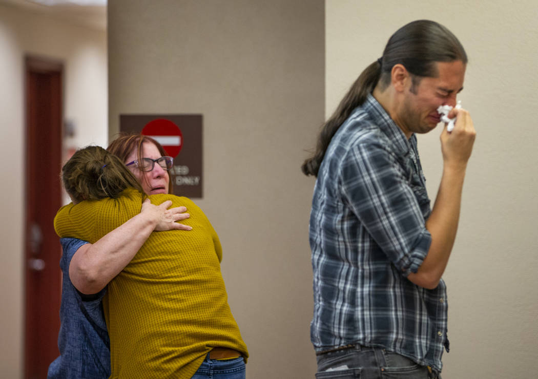 Family members and supporters comfort each other after former Metro officer Pamela Bordeaux, ch ...