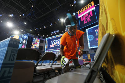 A worker cleans seating on the NFL stage ahead of the first-round NFL Draft, Wednesday, April 2 ...