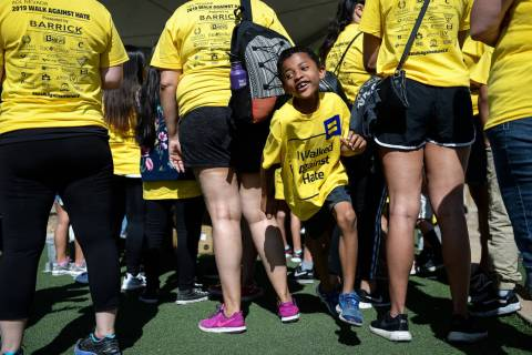Alex Saunders, 6, from Las Vegas runs through a crowd of people during the Anti-Defamation Leag ...