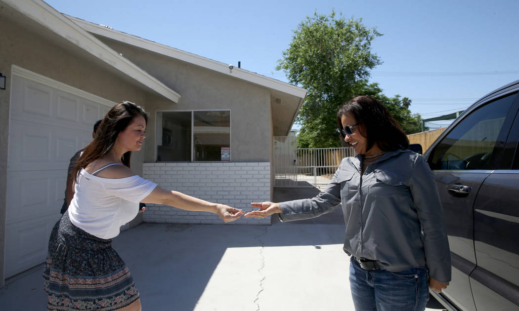 Ana Martinez, a veteran who was homeless two years ago, gets the key to her Las Vegas home from ...