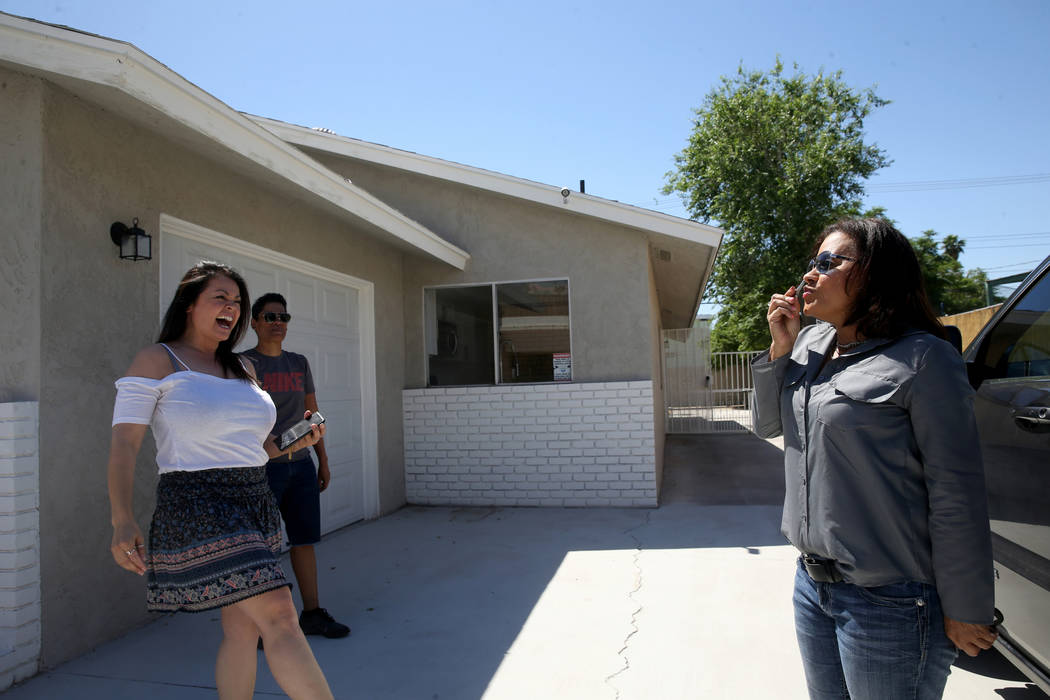 Ana Martinez, a veteran who was homeless two years ago, kisses the key to her new Las Vegas hom ...