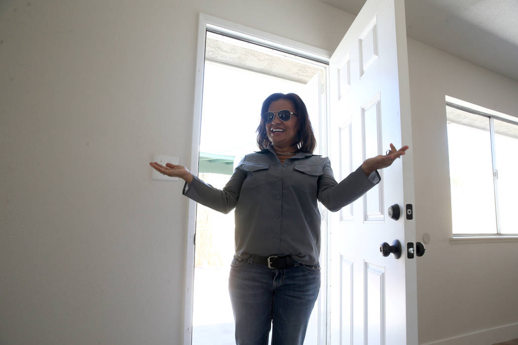 Ana Martinez, a veteran who was homeless two years ago, walks into her new Las Vegas home for t ...