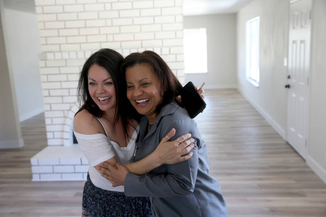 Ana Martinez, right, a veteran who was homeless two years ago, hugs her agent Sonja Catlin afte ...