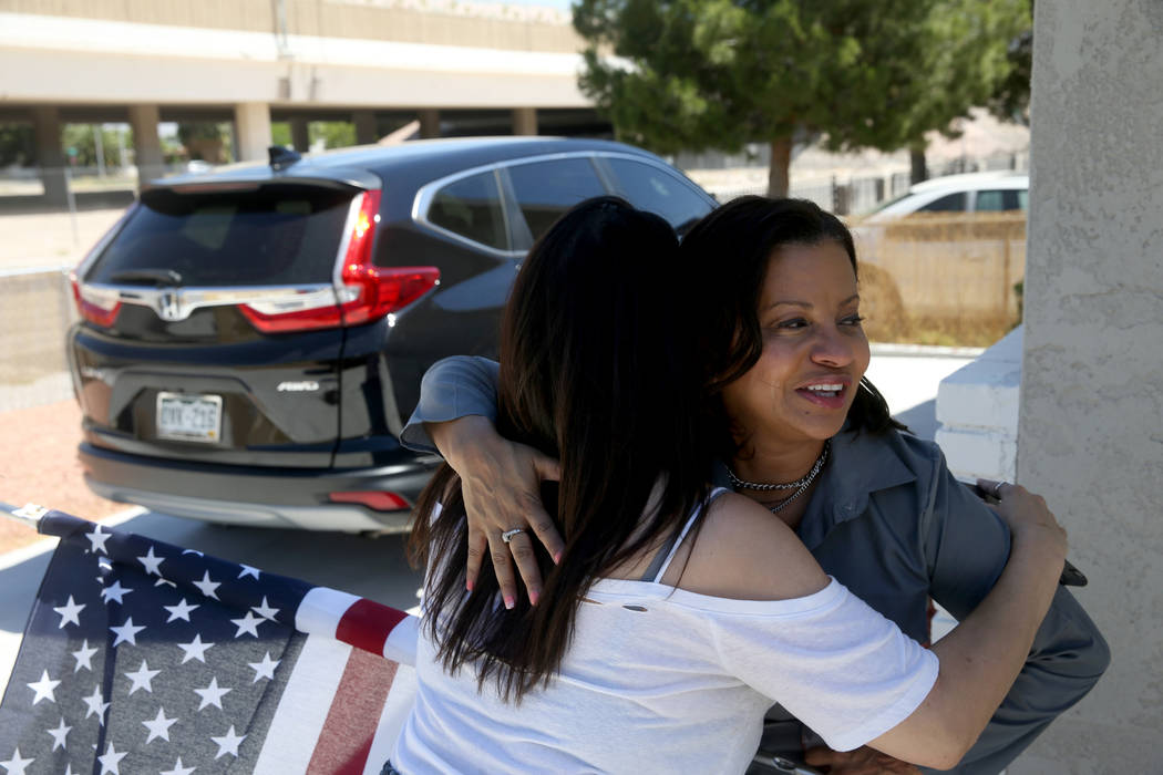Ana Martinez, a veteran who was homeless two years ago, hugs her agent Sonja Catlin as she pre ...