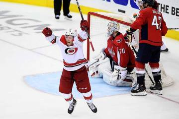 Carolina Hurricanes left wing Brock McGinn, left, celebrates his game-winning goal during doubl ...