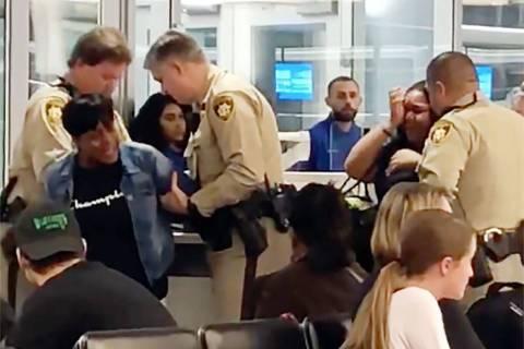 Rosetta Swinney is arrested by Las Vegas police at McCarran International Airport on Saturday, ...