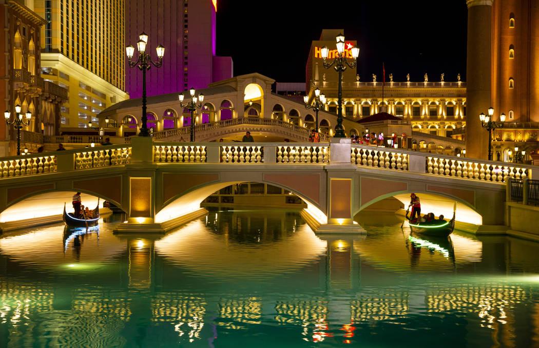 Tourists ride gondolas at The Venetian on Wednesday, April 24, 2019, in Las Vegas. (L.E. Baskow ...