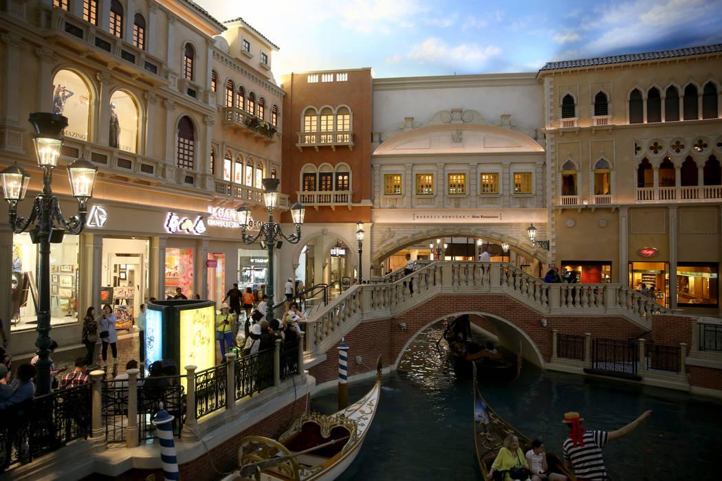 Gondolas float past St. Mark's Square at The Venetian on the Strip in Las Vegas Thursday, April ...