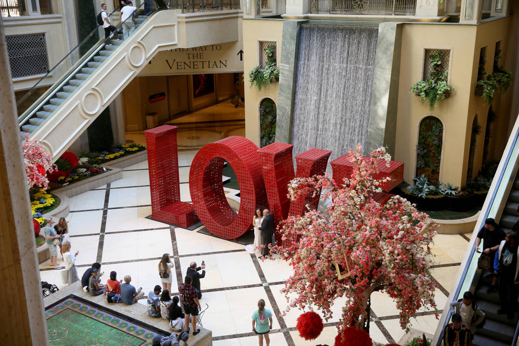 Guests mingle in the Waterfall Atrium at The Venetian on the Strip in Las Vegas Thursday, April ...