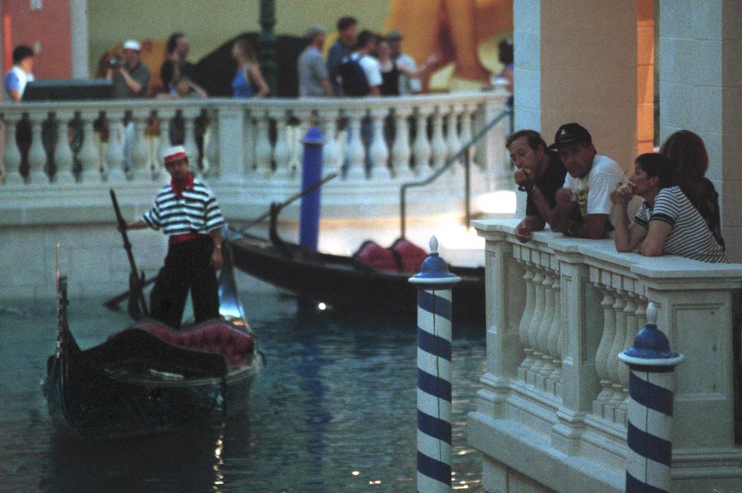 A gondola operator floats on the Grand Canal in the Venetian on Wednesday afternoon. Wednesday ...