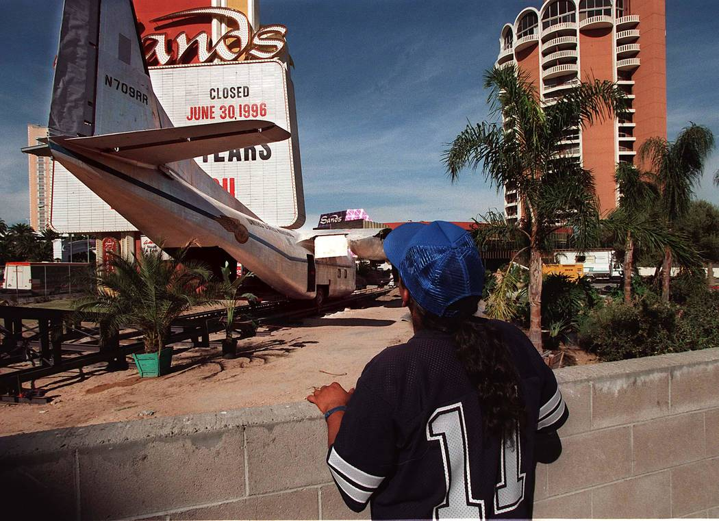 Andrew Moran of Las Vegas, checks out the airplane movie prop set up front of the Sands hotel-c ...