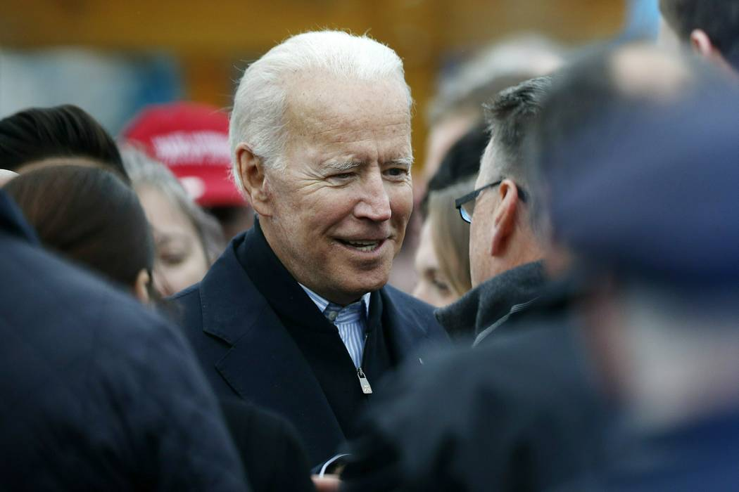 FILE - In this April 18, 2019, file photo, former vice president Joe Biden talks with officials ...