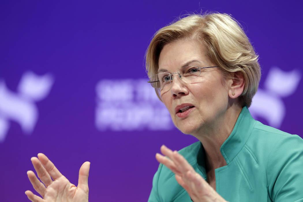 Democratic presidential candidate Sen. Elizabeth Warren, D-Mass., answers questions during a pr ...