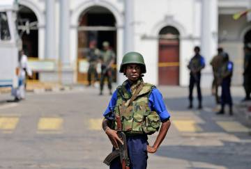Sri Lankan navy soldiers secure the area out side St. Anthony's Church in Colombo, Sri Lanka, T ...