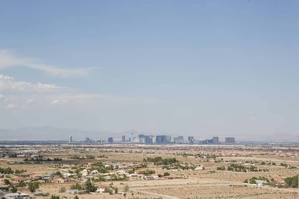 A view of the Las Vegas Strip from Exploration Peak Park. A near-record high of 95 degrees is f ...