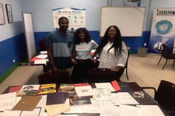 Anthony, Antoinette and Yolanda Love take a photo with some of the 115 college acceptance lette ...