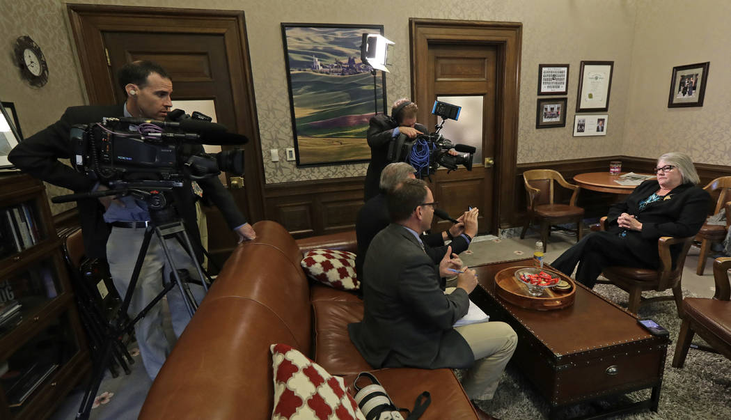 Sen. Maureen Walsh, R-College Place, right, talks to reporters, Monday, April 22, 2019, at the ...