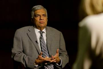 Sri Lankan Prime Minister Ranil Wickremesinghe takes a question during an interview with the As ...