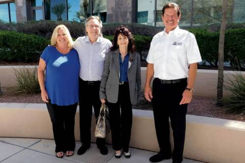 Andrea Hall and Rick Piette, far left and right, of Premier Mortgage with homebuyers John and S ...